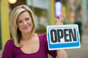 Pretty woman with open sign